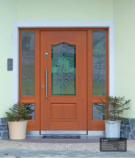 Wooden front doors with traditional contours RUSTIKAL